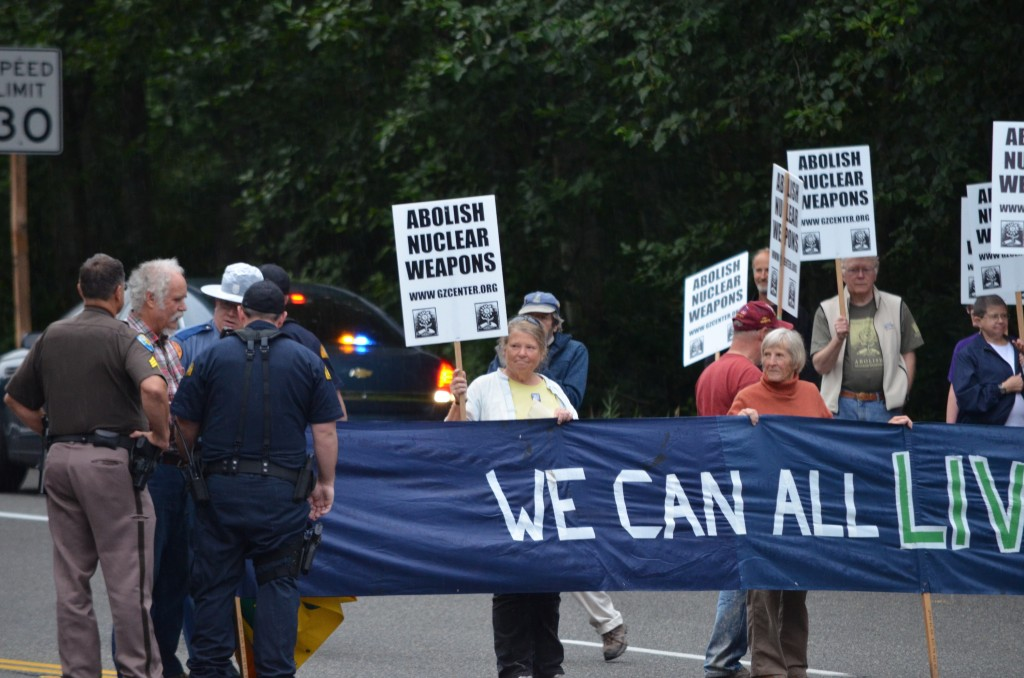 Doug (at far left) during the August blockade as State Patrol officers move resisters off the roadway. (photo by Glen Milner)