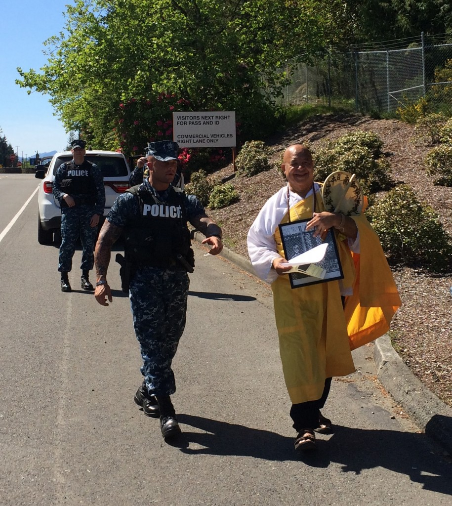 Brother Gilberto Perez, of the Bainbridge Island Nipponzan Miyohoji Buddhist Temple, being released by Navy security personnel after his arrest and processing