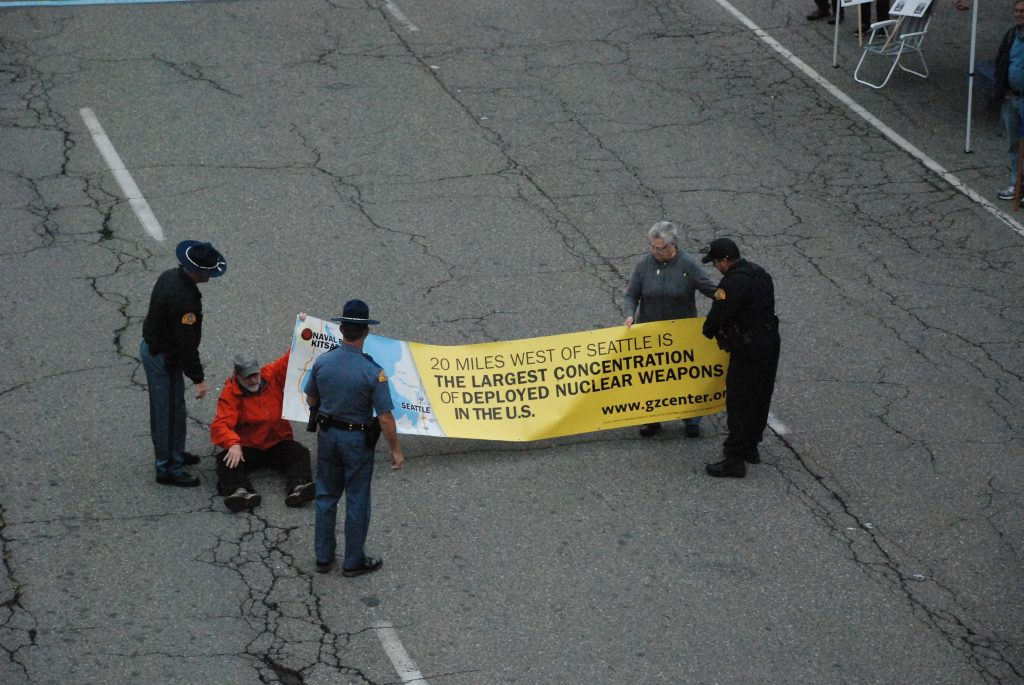 Sue Ablao and Mack Johnson blocking the roadway on August 8th