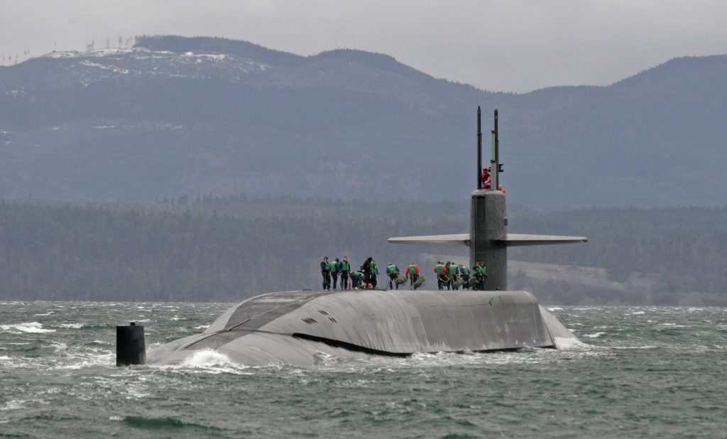 The USS Ohio sailing in the Strait of Juan de Fuca. The Trident nuclear submarine has been converted to a guided missile submarine. It was first launched in 1979, and was the original nuclear submarine in the U.S. Pacific Fleet stationed at what is now Naval Base Kitsap. (Steve Ringman/The Seattle Times)